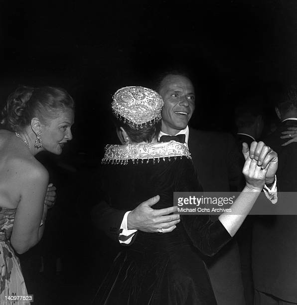 Frank Sinatra dances with actress and singer Judy Garland at the party celebrating the premiere of the Warner Bros film 'A Star Is Born' on September...