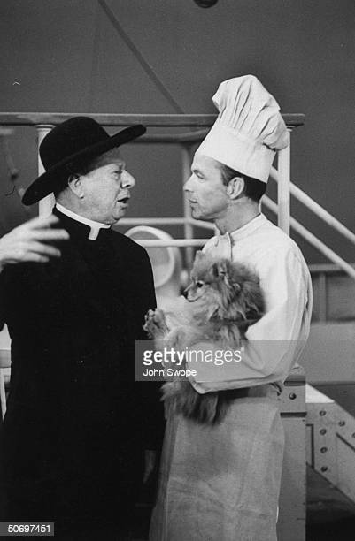Frank Sinatra disguised as chef holding Pomeranian dog w Bert Lahr in priest's costume during preliminary rehearsal for Cole Porter's musical...