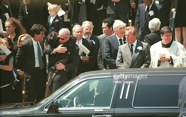 Frank Sinatra Jr Tina Sinatra consoled by a guest GSchlatter W Newton Gregory Peck RWagner