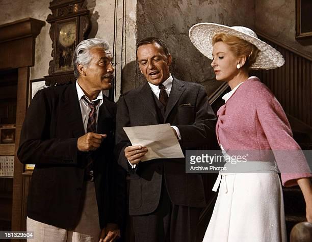 Frank Sinatra sings next to Deborah Kerr in a scene from the film 'Marriage On The Rocks' 1965