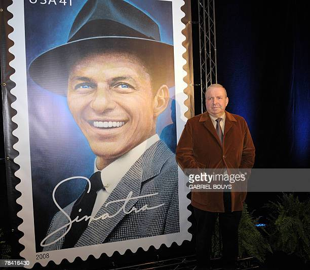 Frank Sinatra's son Frank Jr poses in front of the new United States Postal Service stamp in tribute to his father 12 December 2007 in Beverly Hills...