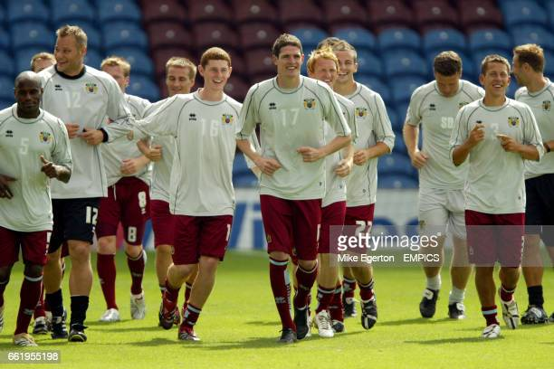 Frank Sinclair Chris McCann Kyle Lafferty and Jon Harley of Burnley Football Club in training with other members of the first team