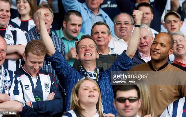 Frank SKinner a long time fan of West Bromwich Albion celebrates his team win to the Premiership during the Nationwide Division One match between...