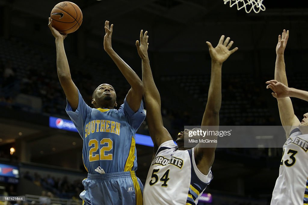 Frank Snow #22 of the Southern Jaguars drives to the hoop with Davante Gardner #54 of the Marquette Golden Eagles defending during the second half at BMO Harris Bradley Center on November 08, 2013 in Madison, Wisconsin.