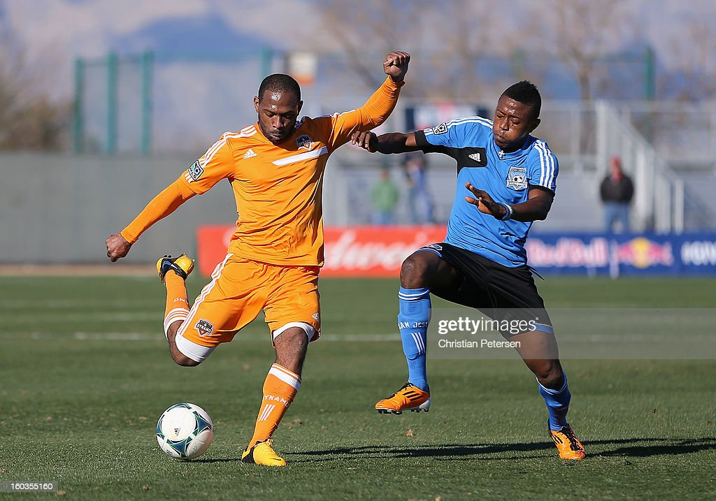 Frank Songo'o #39 (L) of the Houston Dynamo shoots the ball against the San Jose Earthquakes during The Desert Friendlies Presented By FC Tucson at Kino Sports Complex on January 29, 2013 in Tucson, Arizona. The Earthquakes defeated the Dynamo 2-0.