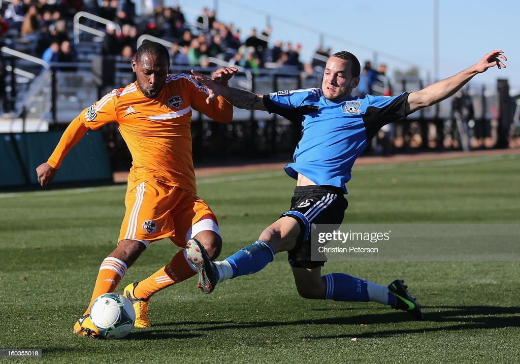 Frank Songo'o #39 of the Houston Dynamo shoots the ball as Colin Mitchell #36 of the San Jose Earthquakes defends during The Desert Friendlies Presented By FC Tucson at Kino Sports Complex on January 29, 2013 in Tucson, Arizona. The Earthquakes defeated the Dynamo 2-0.