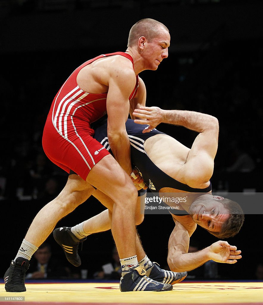 Frank Stabler of Germany fights with Georgian Carpen of Romania during Men's GrecoRoman 66kg category final match at the European Wrestling...