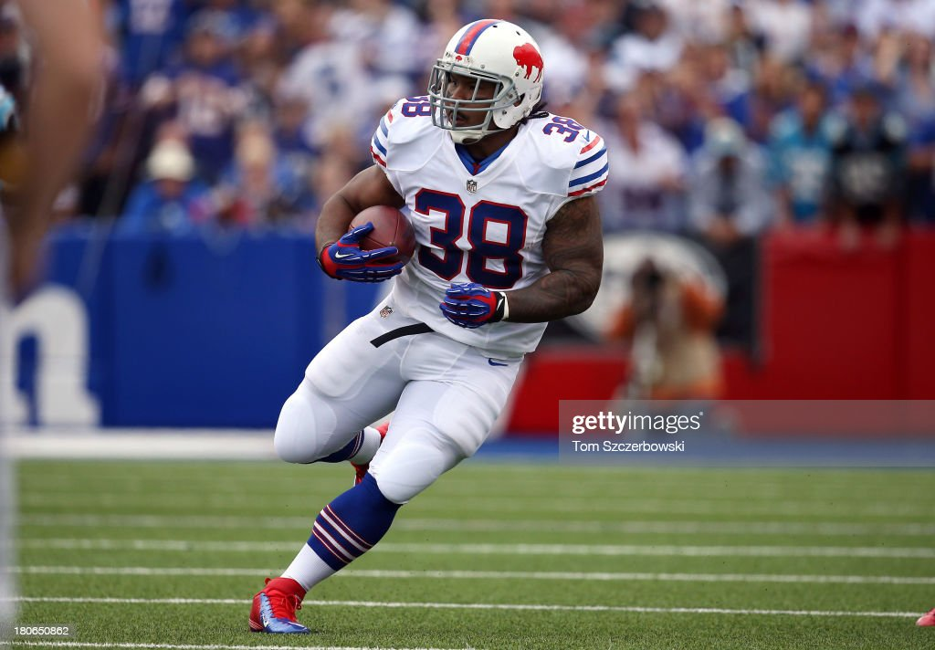 Frank Summers #38 of the Buffalo Bills carries the ball during NFL game action against the Carolina Panthers at Ralph Wilson Stadium on September 15, 2013 in Orchard Park, New York.