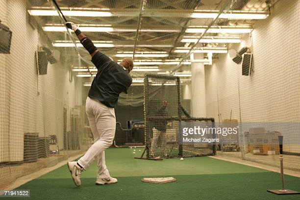 Frank Thomas of the Oakland Athletics hits in the clubhouse before the game against the Texas Rangers at McAfee Coliseum in Oakland California on...