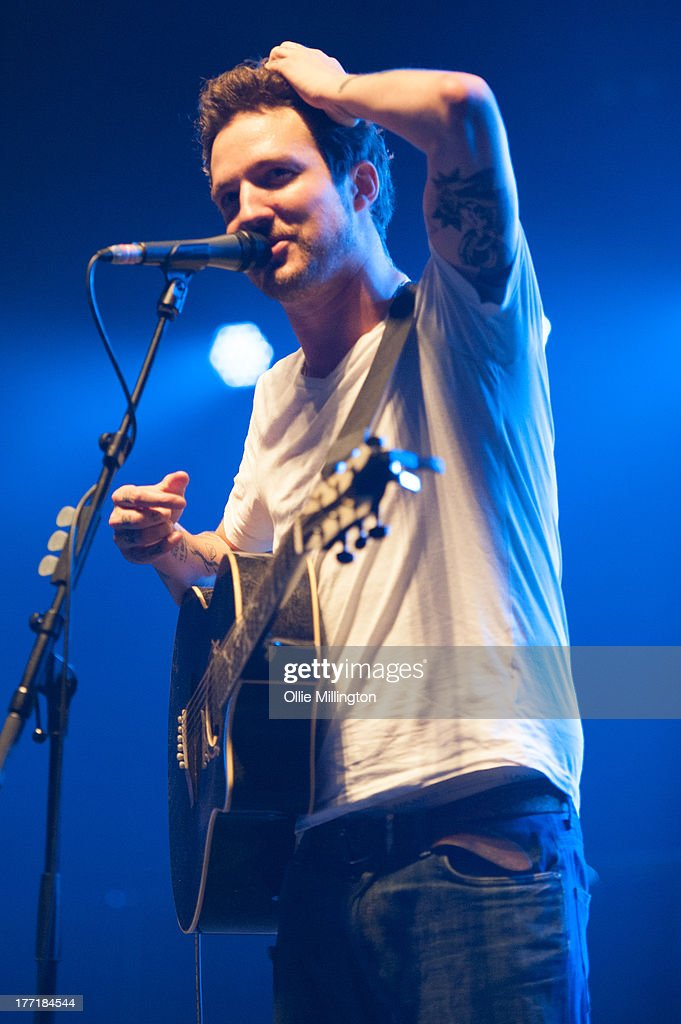 <a gi-track='captionPersonalityLinkClicked' href=/galleries/search?phrase=Frank+Turner&family=editorial&specificpeople=1259153 ng-click='$event.stopPropagation()'>Frank Turner</a> performs onstage at Brixton Academy on August 21, 2013 in London, England.
