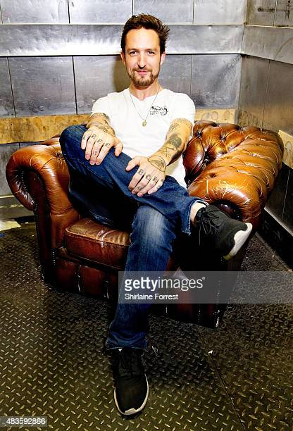 Frank Turner poses backstage before performing live and signing copies of his new album 'Positive Songs For Negative People' at HMV on August 10 2015...