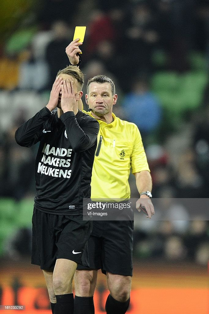 Frank van Mosselveld of RKC Waalwijk, Referee Pieter Vink, during the Dutch Eredivisie match between FC Groningen and RKC Waalwijk at the Euroborg on february 9, 2013 in Groningen, The Netherlands