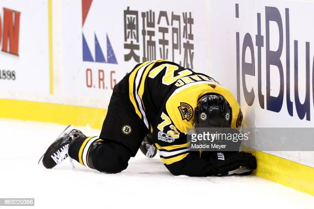 Frank Vatrano of the Boston Bruins after being checked into the boards by Erik Gudbranson of the Vancouver Canucks during the first period at TD...