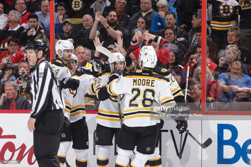 Frank Vatrano #72 of the Boston Bruins celebrates his third-period goal against the Ottawa Senators with teammates Adam McQuaid #54, Dominic Moore #28, Riley Nash #20 John-Michael Liles #26 in Game One of the Eastern Conference First Round during the 2017 NHL Stanley Cup Playoffs at Canadian Tire Centre on April 12, 2017 in Ottawa, Ontario, Canada.