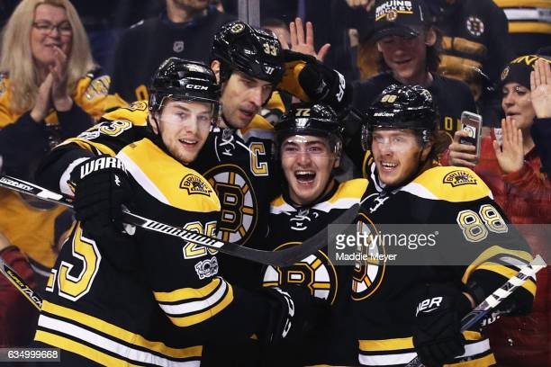 Frank Vatrano of the Boston Bruins celebrates with David Pastrnak Zdeno Chara and Brandon Carlo after scoring against the Montreal Canadiens at TD...