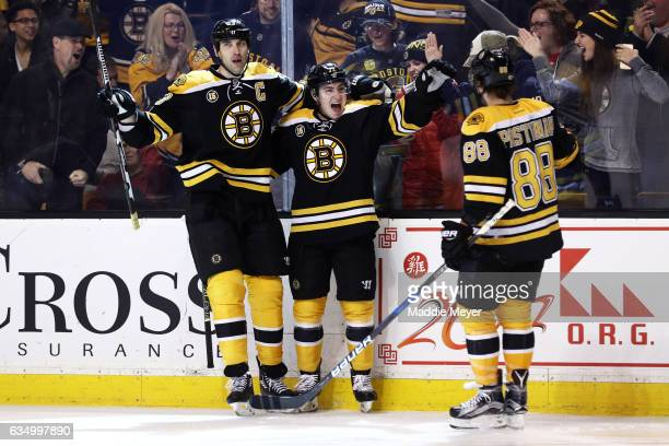 Frank Vatrano of the Boston Bruins celebrates with Zdeno Chara and David Pastrnak after scoring against the Montreal Canadiens at TD Garden on...