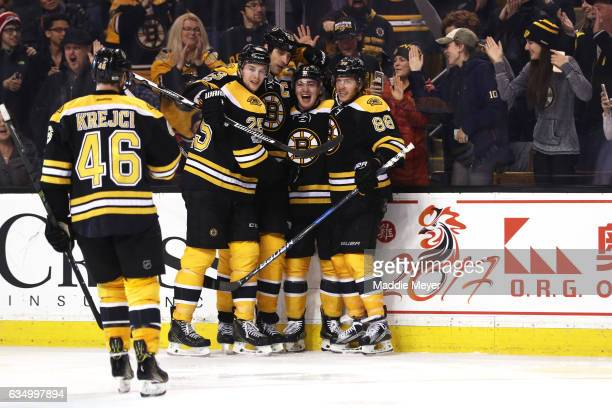 Frank Vatrano of the Boston Bruins celebrates with Zdeno Chara David Krejci and David Pastrnak after scoring against the Montreal Canadiens at TD...