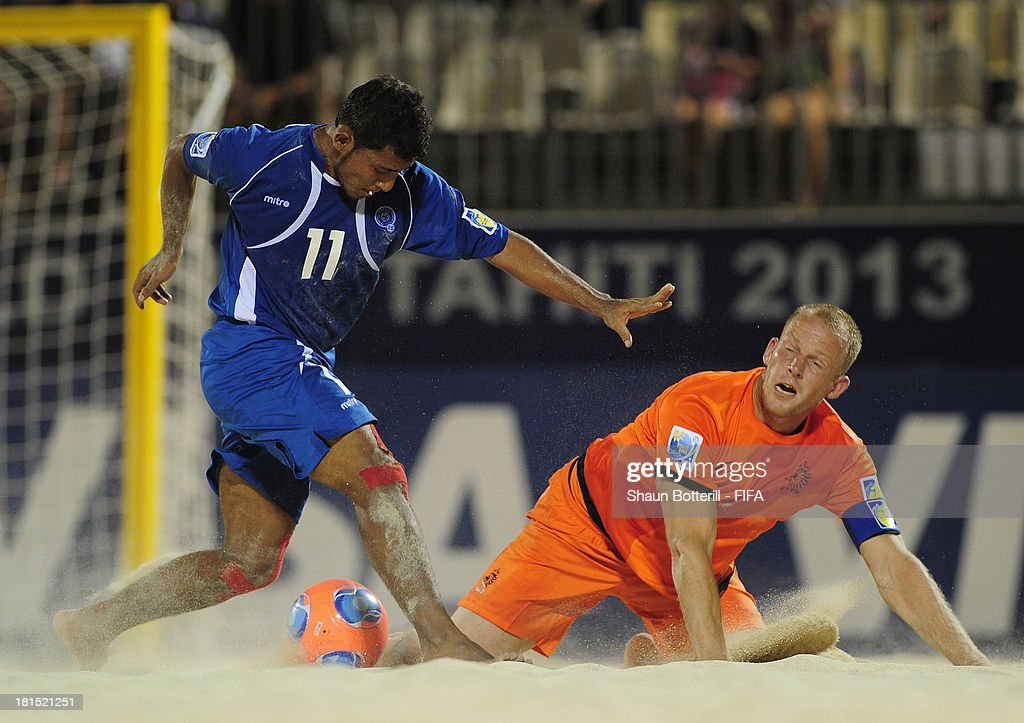 Frank Velasquez of El Salvador is challenged by Patrick Ax of Netherlands during the FIFA Beach Soccer World Cup Tahiti 2013 Group B match between El Salvador and Netherlands at the Tahua To'ata stadium on September 21, 2013 in Papeete, French Polynesia.