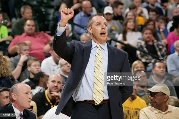 Frank Vogel Head Coach of the Indiana Pacers celebrates during a game against the Minnesota Timberwolves at Bankers Life Fieldhouse on October 7 2014...