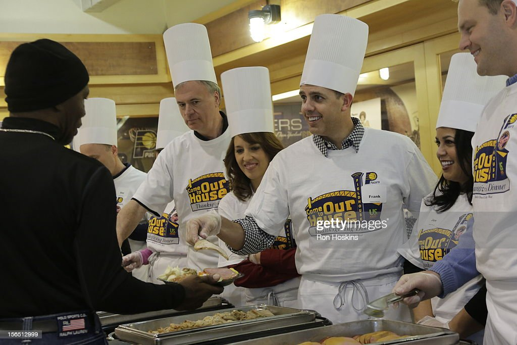 Frank Vogel, head coach of the Indiana Pacers serves up a dish as part of the Pacers 15th Annual 'Come to Our House' Thanksgiving Dinner at Bankers Life Fieldhouse on November 15, 2012 in Indianapolis, Indiana.