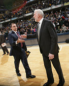 Frank Vogel head coach of the Indiana Pacers shakes hands with Gregg Popovich head coach of the San Antonio Spurs after the game on February 9 2015...
