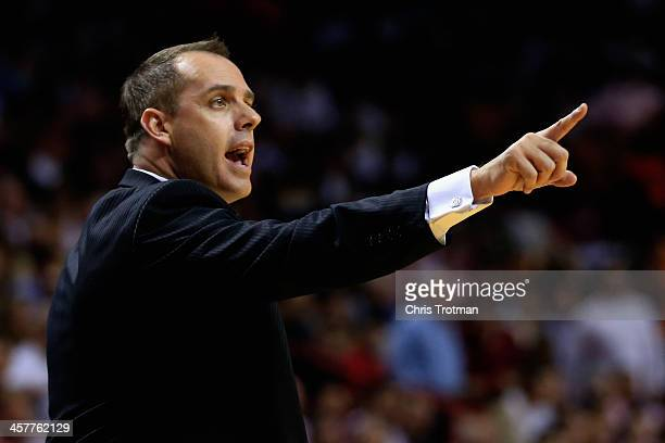 Frank Vogel of the Indiana Pacers coaches against the Miami Heat at American Airlines Arena on December 18 2013 in Miami Florida NOTE TO USER User...