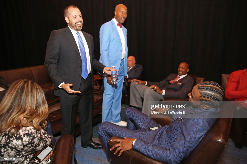 Frank Vogel of the Orlando Magic talks with Andrew Wiggins #22 of the Minnesota Timberwolves during the 2017 NBA Draft Lottery at the New York Hilton in New York, New York.