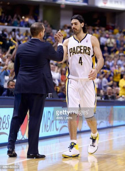 Frank Vogel the head coach of the Indiana Pacers congratulates Luis Scola as he leaves the game in the final minutes of the 10185 won over the...