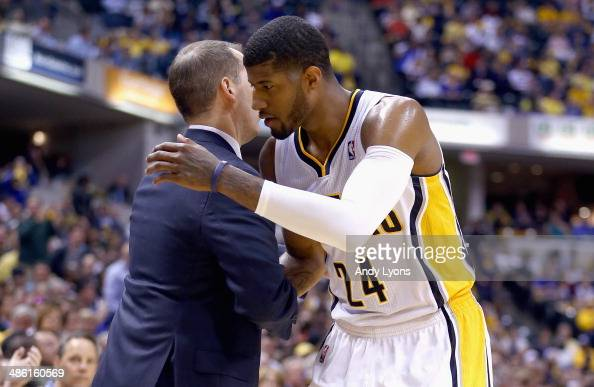 Frank Vogel the head coach of the Indiana Pacers congratulates Paul George as he leaves the game in the final minutes of the 10185 won over the...