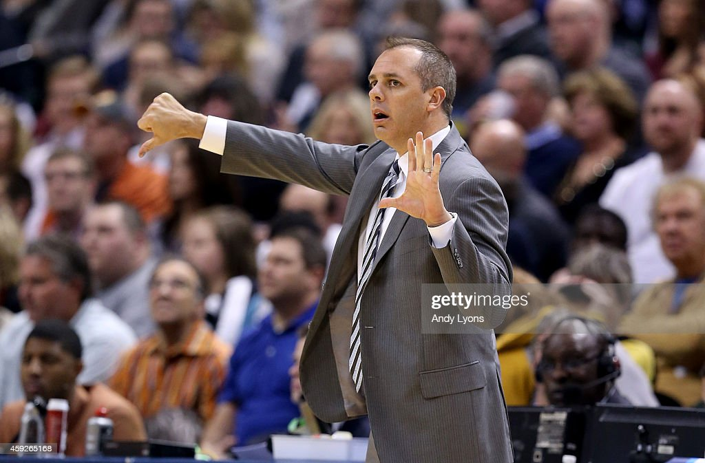 Frank Vogel the head coach of the Indiana Pacers gives instructions to his team during the game against the Charlotte Hornets at Bankers Life...
