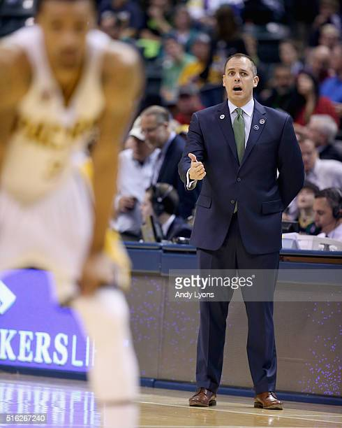 Frank Vogel the head coach of the Indiana Pacers gives instructions to his team during the game against the Toronto Raptors at Bankers Life...