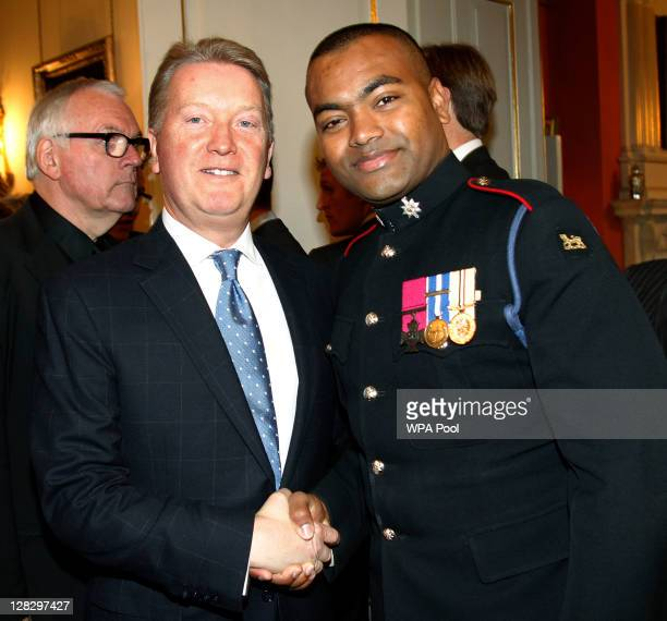 Frank Warren meets Johnson Beharry at the Tickets For Troops reception attended by Samantha Cameron at 10 Downing Street on October 6 2011 in London...