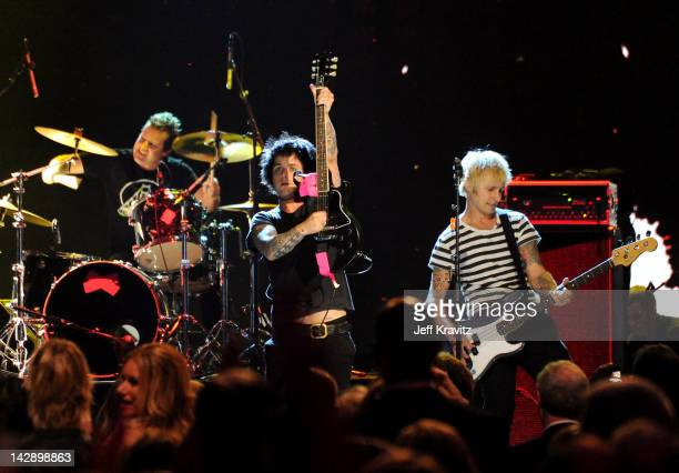 Frank Wright AKA Tre Cool Billie Joe Armstrong and Mike Dirnt of Green Day perform on stage at the 27th Annual Rock And Roll Hall Of Fame Induction...