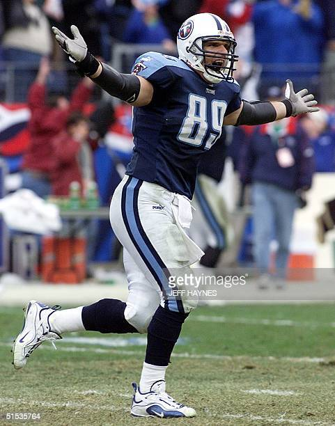 Frank Wycheck of the Tennessee Titans celebrates after throwing a lateral to Kevin Dyson on a kickoff return for a touchdown during the second half...