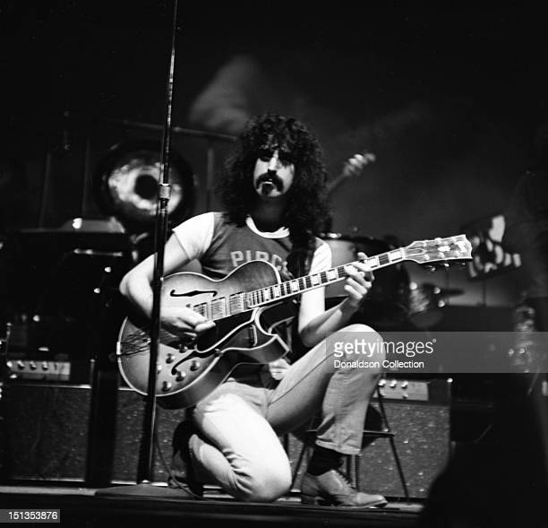 Frank Zappa of the rock group 'Frank Zappa And The Mothers Of Invention' perform onstage at the Garrick Theatre upstairs from the Cafe Au Go Go on...
