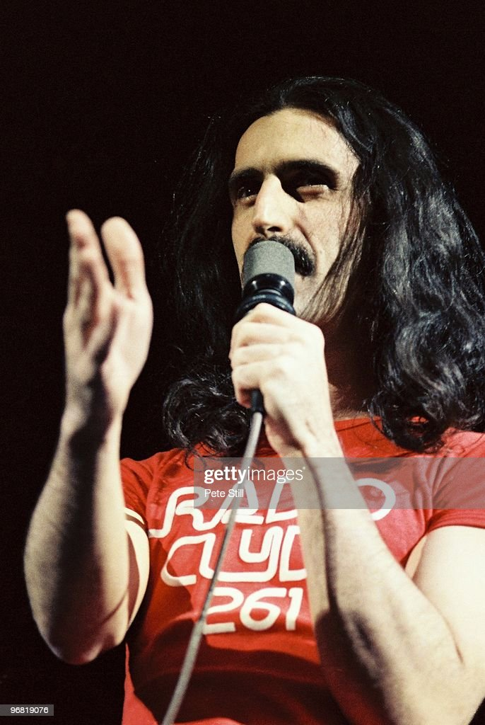 <a gi-track='captionPersonalityLinkClicked' href=/galleries/search?phrase=Frank+Zappa&family=editorial&specificpeople=226624 ng-click='$event.stopPropagation()'>Frank Zappa</a> performs on stage at Hammersmith Odeon, on December 18th, 1979 in London, United Kingdom.