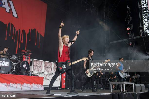 Frank Zummo Deryck Whibley Jason McCaslin and Dave Baksh of SUM 41 perform on stage during the second day of 'Rock am Ring' on June 3 2017 in...