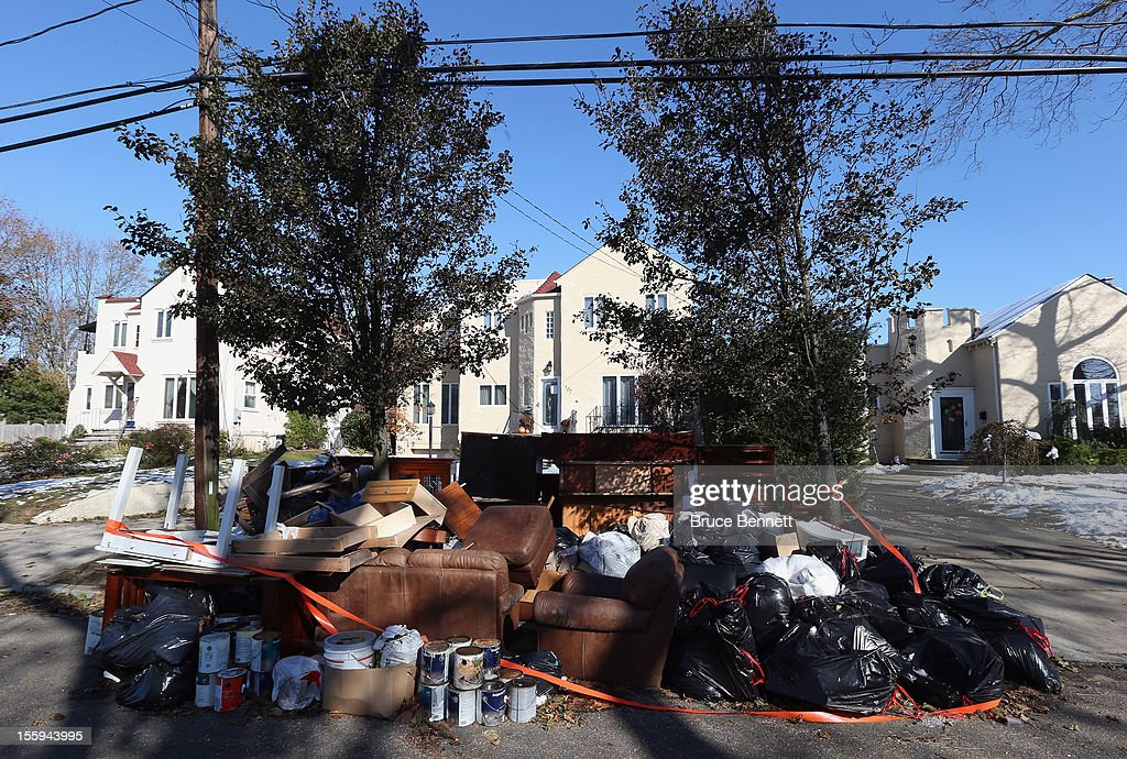 Frankel Boulevard is littered with contents from flooded homes in the aftermath of Superstorm Sandy on November 9, 2012 in Merrick, New York. New York Gov. Andrew M. Cuomo has said that the economic loss and damage to homes and businesses caused by Sandy could total $33 billion in New York, according to published reports.