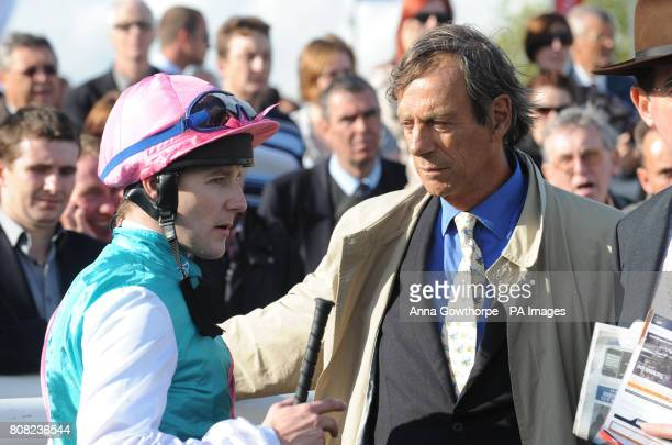 Frankel jockey Tom Queally talks to trainer Henry Cecil after winning the Frank Whittle Partnership Conditions Stakes on The Welcome To Yorkshire...