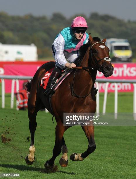 Frankel ridden by Tom Queally wins the Frank Whittle Partnership Conditions Stakes on The Welcome To Yorkshire Doncaster Cup Day at Doncaster...
