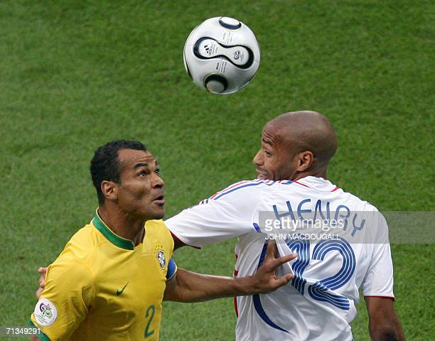 French forward Thierry Henry clashes with Brazilian defender Cafu during the quarterfinal World Cup football match between Brazil and France at...
