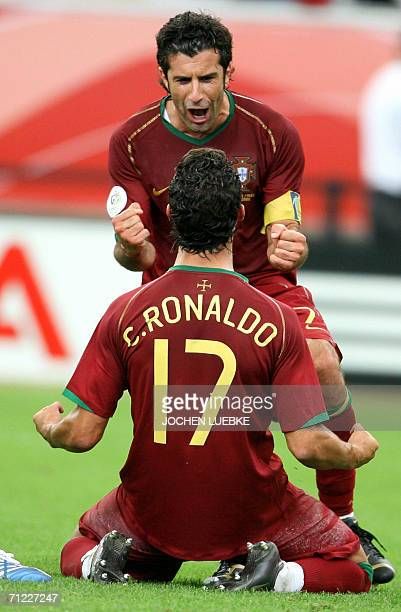 Portuguese forward Luis Figo celebrates with forward Cristiano Ronaldo after the latter scored during the World Cup 2006 group D football game...