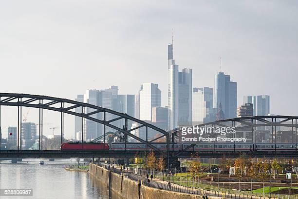 Frankfurt skyline with train on a bridge
