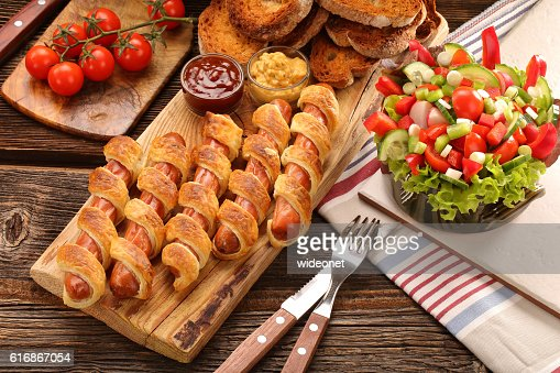 Frankfurters rolled sausages baked in puff pastry : Stock Photo