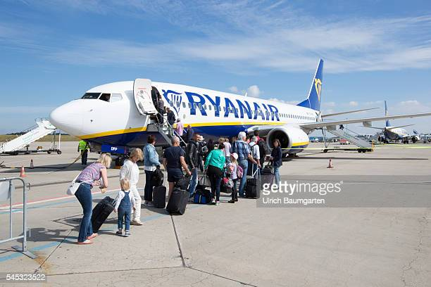 FrankfurtHahn Airport Passengers board a Ryanair passenger plane