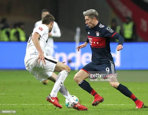 Frankfurt's Argentinian defender David Abraham and Bayern Munich's Polish forward Robert Lewandowski vie for the ball during the German first...