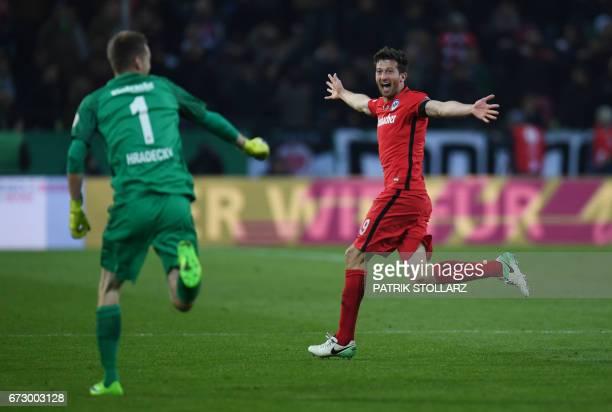 Frankfurt's Argentinian defender David Abraham and Frankfurt's Finnish goalkeeper Lukas Hradecky react after the German Cup DFB Pokal semifinal...