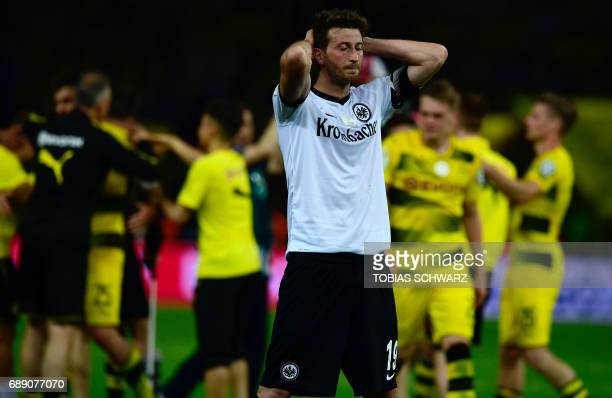 Frankfurt's Argentinian defender David Abraham looks dejected after the German Cup final football match Eintracht Frankfurt v BVB Borussia Dortmund...