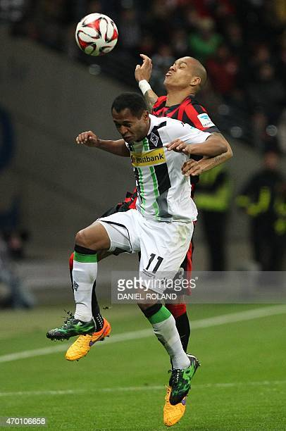 Frankfurt's Brazilian defender Bamba Anderson and Moenchengladbach's Brazilian midfielder Raffael vie for the ball during the German first division...