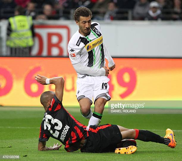 Frankfurt's Brazilian defender Bamba Anderson and Moenchengladbach's US defender Fabian Johnson vie for the ball during the German first division...